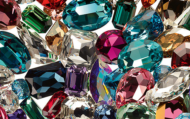 Burst of colorful crystals in greens, pinks, purples, yellows, blues and clear.