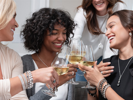 4 women toasting wine at a home jewelry party